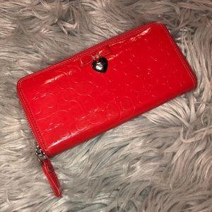 Coach monogrammed coral heart zip wallet